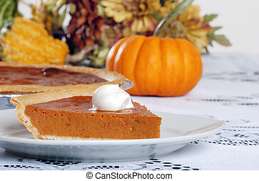 pumpkin pie and whip cream with gourds