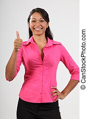 Success thumbs up from young woman