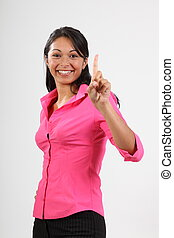 Number one hand gesture - Smiling young woman wearing pink...