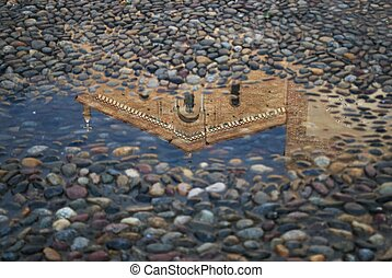 Reflection of a church in a puddle - Magic reflection of a...