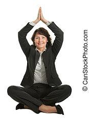 Businesswoman sitting in lotus position - Businesswoman...