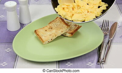 Scrambled Eggs From The Pan - Serving scrambled eggs from a...
