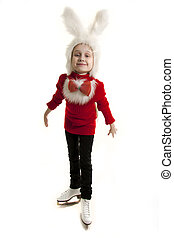 Girl in a cap of a bunny standing on the skates