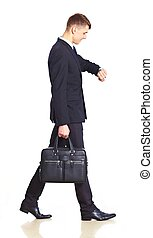 Businessman walking with bag