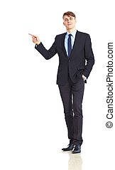Young adult businessman pointing, isolated over white...