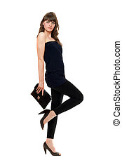 Attractive girl in black leggings with a handbag. Isolated