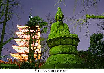 Asakusa, Tokyo - night image of Buddha statue and five...
