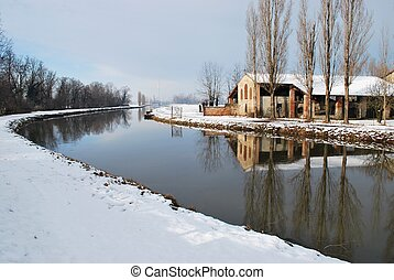River and country house in winter