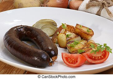 home made black pudding with grilled potato