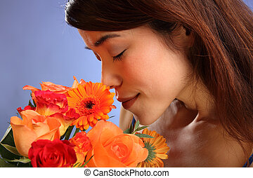 Japanese girl smelling flowers - Flowers for you. Beauty...