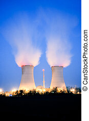 Nuclear power plant at dusk - Nuclear power plant blowing...