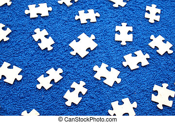 Puzzle on a dark blue fabric