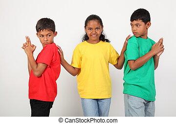 Three playful school friends ready