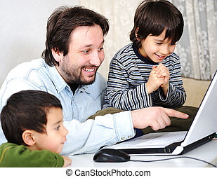 Dad and sons with laptop