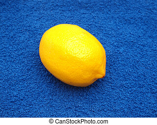 Lemon on a dark blue fabric