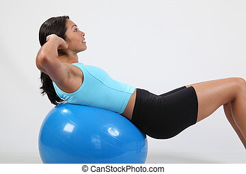 Athletic girl doing crunches