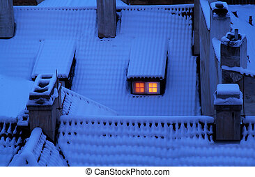 Snow covered rooftops at twilight