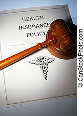health insurance policy and law gavel