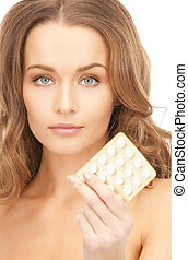 young beautiful woman with pills - picture of young...