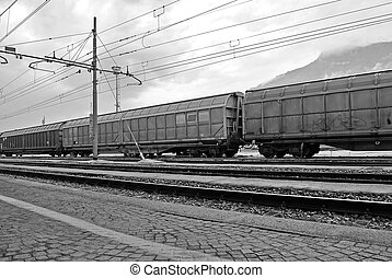 freight train stopped at the station with the background...