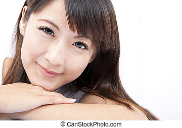 Closeup portrait of a smiling  young asian woman isolated on white background