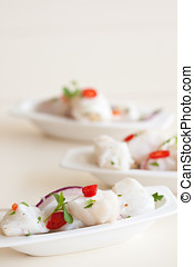 Fresh ceviche - Small seafood dish with raw cod marinated in...