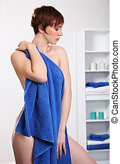 Beautiful woman using towel - Beautiful woman drying of with...