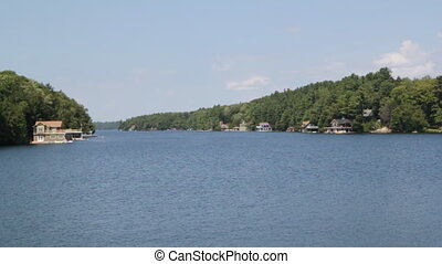 Muskoka channel. - Channel of water with cottages on the...