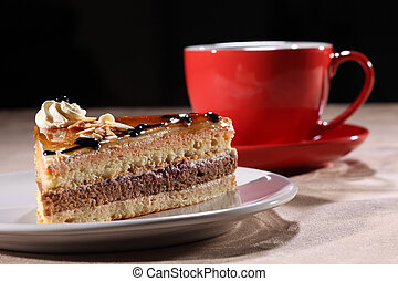 Slice of dessert cake with coffee for break time