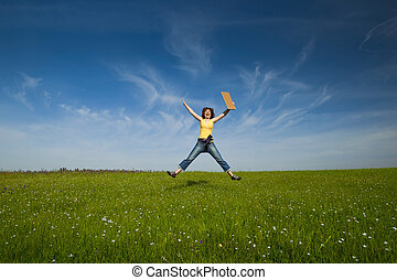 Girl with a paper card - Beautiful young woman jumping and...