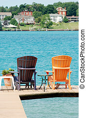 brown and orange adirondack chairs