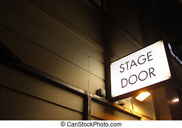 Stage door by night - Theatre sign illuminates the night in...