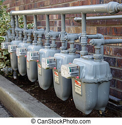 Row of gas meters with full manifolding - Row of gray gas...