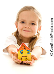 Little girl holding her clay house