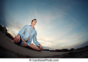 Young Man Meditating - Young Caucasian man meditating...