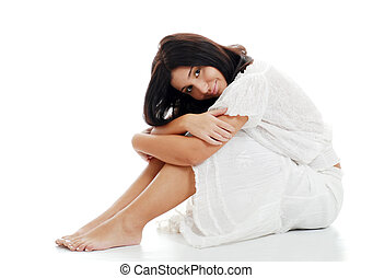 Young woman leaning on her knees - isolated Young woman...