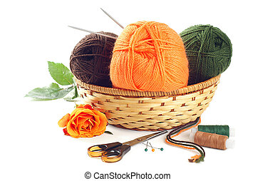Woolen yarn - Three clews of woolen yarn in wicker basket...
