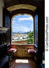 View from window with stone cahirs in house of Columb Santo Domingo Dominican Republic
