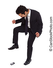 Businessman stomping on his phoneq - Businessman is crushing...
