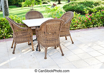 Brown wooden chairs an tables on patio