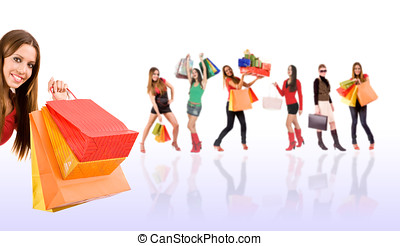 Beautiful shopping girl with colorful bags and blurred woman...