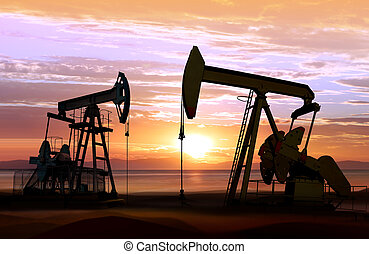 oil pumps on sunset - silhouette of working oil pumps on...