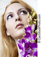 Beauty woman face and flowers closeup