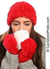 Woman with warm woollies and mug