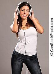 Girl enjoying music on headphones