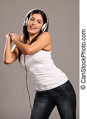 Girl dancing and singing to music