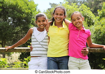 Best friends enjoying a sunny day - Three young girls...