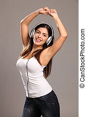 Girl arms raised dancing to music