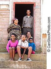 Happy black family - Cheerful black family on the steps...