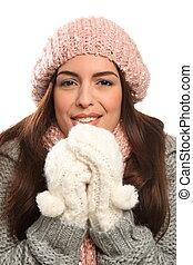 Beautiful young woman keeping warm